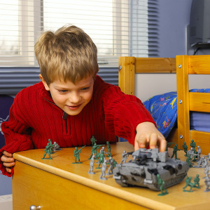 Kid playing with action figures